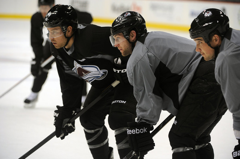 . Defensemen David Jones, left, #54, center John Mitchell, #7 in middle and defensemen Shane O\'Brien, #5, right, line up for the drop of the puck during practice January 17th, 2013. The Colorado Avalanche hit the ice for the first time this season at the Pepsi Center.  After long months of contract negotiations the season has finally started. Helen H. Richardson, The Denver Post