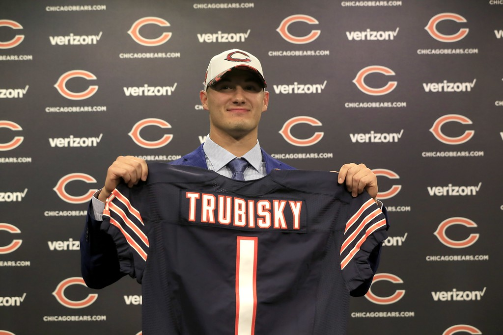 . The Chicago Bears\' first round draft pick quarterback Mitchell Trubisky, from North Carolina, poses with a Bears\' jersey during an NFL football news conference Friday, April 28, 2017, in Lake Forest , Ill. (AP Photo/Charles Rex Arbogast)