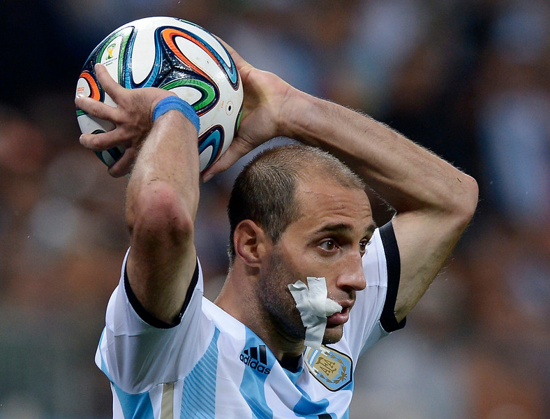 . Argentina\'s Pablo Zabaleta takes a throw in during the World Cup semifinal soccer match between the Netherlands and Argentina at the Itaquerao Stadium in Sao Paulo Brazil, Wednesday, July 9, 2014. (AP Photo/Manu Fernandez)