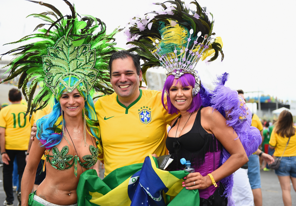 . Brazil fans pose before the 2014 FIFA World Cup Brazil Group A match between Brazil and Mexico at Castelao on June 17, 2014 in Fortaleza, Brazil.  (Photo by Laurence Griffiths/Getty Images)