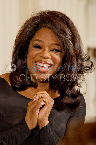 Actress/talk show host Oprah Winfrey awaits her turn to receive the Presidential Medal of Freedom in a ceremony in the East Room.