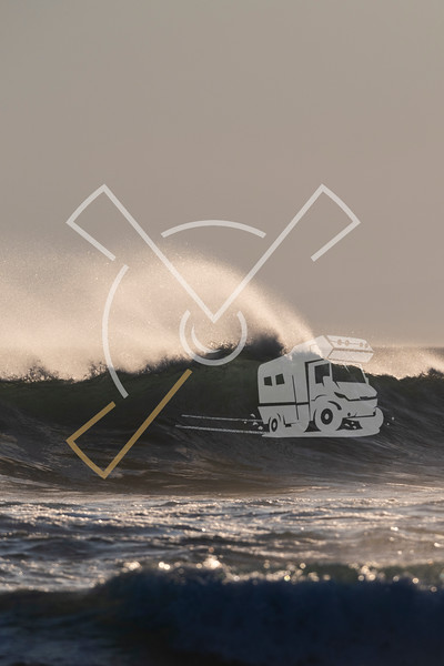 Panoramic image of waives at the surf in backlight