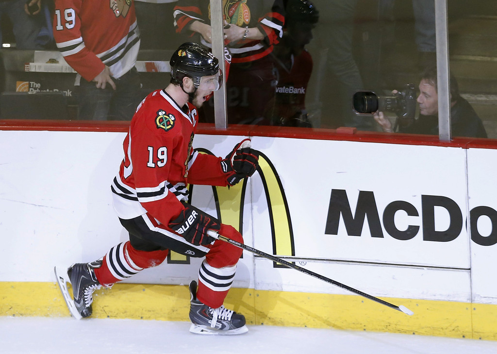 . Chicago Blackhawks center Jonathan Toews celebrates his goal during the third period of Game 1 of the Western Conference finals in the NHL hockey Stanley Cup playoffs against the Los Angeles Kings in Chicago on Sunday, May 18, 2014. The Blackhawks won 3-1. (AP Photo/Charles Rex Arbogast)