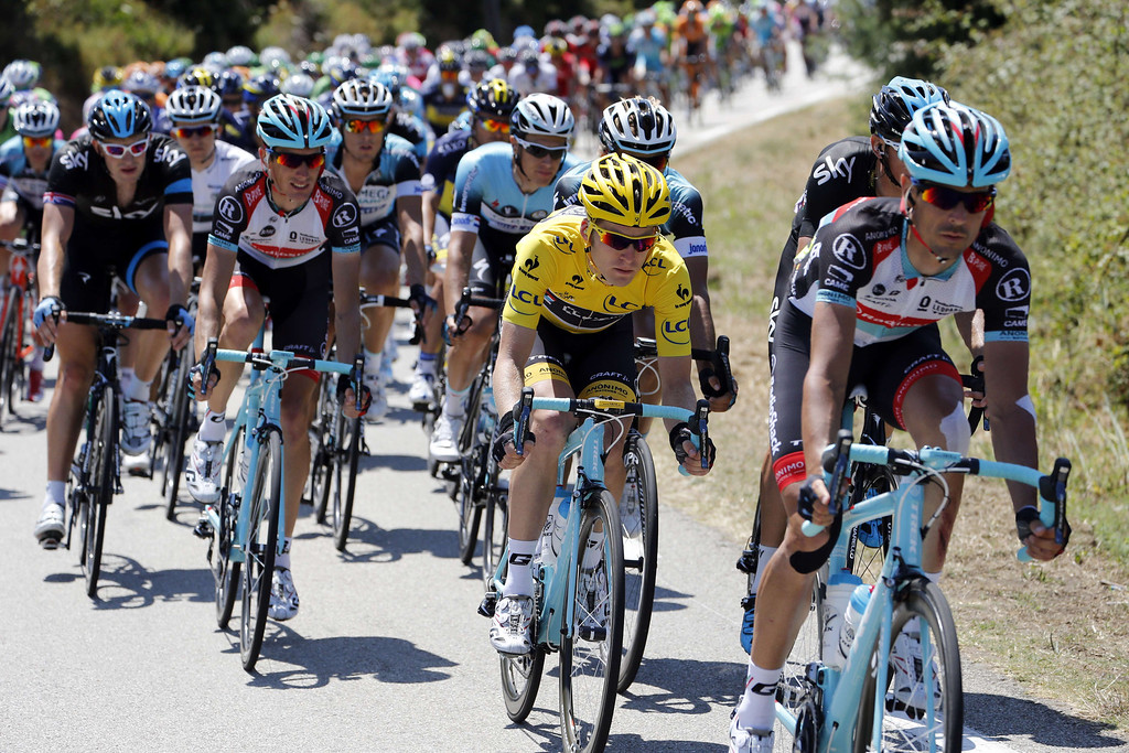 . Overall leader\'s yellow jersey Belgium\'s Jan Bakelants rides in the pack during the 145.5 km third stage of the 100th edition of the Tour de France cycling race on July 1, 2013 between Ajaccio and Calvi, on the French Mediterranean Island of Corsica.  AFP PHOTO / JOEL  SAGET/AFP/Getty Images