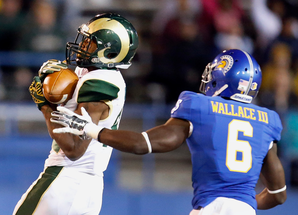 . Colorado State wide receiver Rashard Higgins, left, catches a pass past San Jose State cornerback Cleveland Wallace III (6) during the second half of an NCAA college football game Saturday, Nov. 1, 2014, in San Jose, Calif. (AP Photo/Tony Avelar)