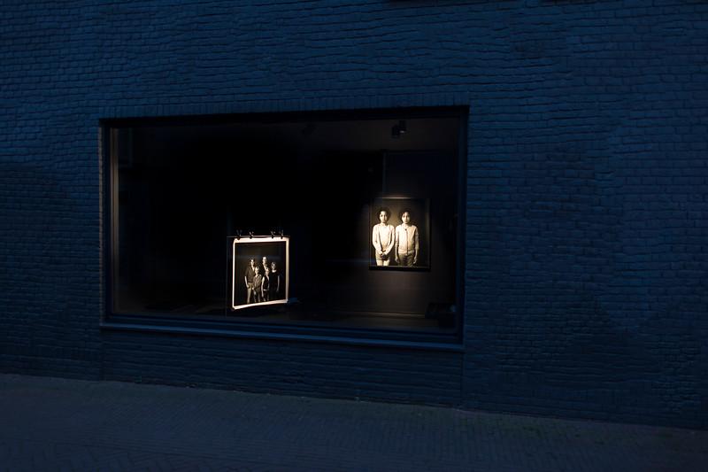 Portraits in a window