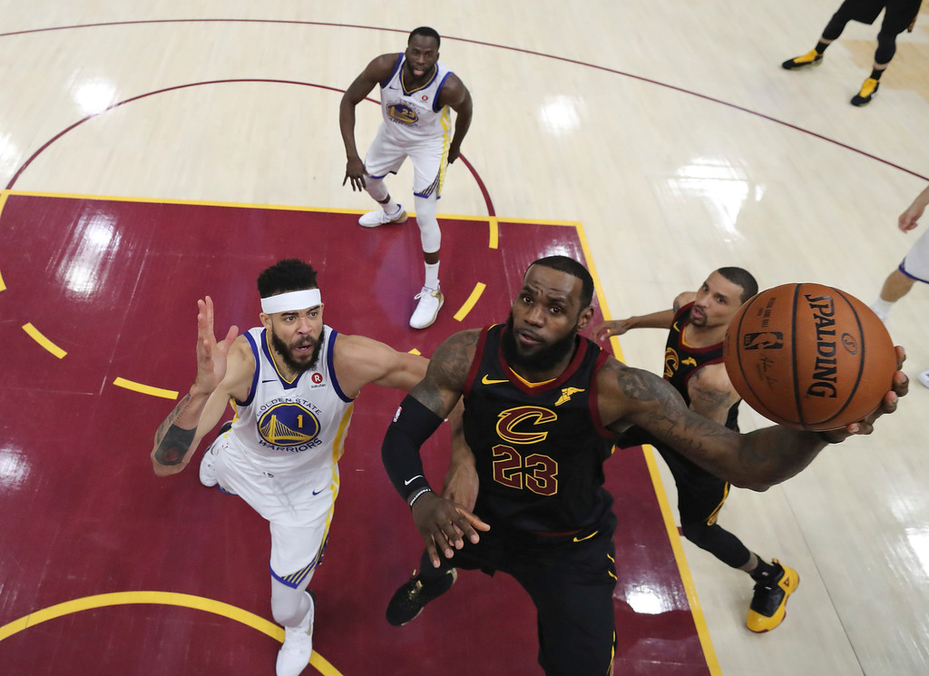 . Cleveland Cavaliers\' LeBron James shoots against Golden State Warriors\' JaVale McGee during the first half of Game 4 of basketball\'s NBA Finals, Friday, June 8, 2018, in Cleveland. (Kyle Terada/Pool Photo via AP)