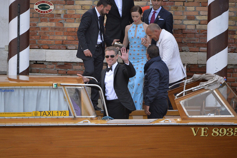 """. US actor Matt Damon boards a taxi boat at the Cipriani hotel on September 27, 2014 in Venice where US actor George Clooney and British fiancee, Amal Alamuddin celebrate their wedding. George Clooney has said goodbye to bachelorhood in Venice with a stag party at his favorite restaurant with Hollywood chums, and was gearing up for a day of glamorous pre-wedding celebrations. The actor had swept into the floating city yesterday with his British fiancee Amal Alamuddin on a watertaxi dubbed \""""Amore\"""", zipping up the Grand Canal to cheers from fans at the start of nuptials set to draw out over the weekend.  ANDREAS SOLARO/AFP/Getty Images"""