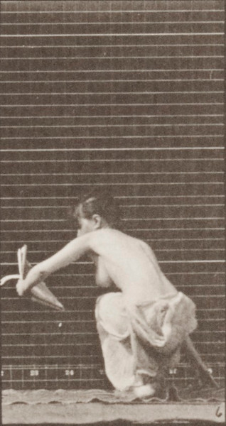Semi-nude woman arising from the ground with a paper in left hand