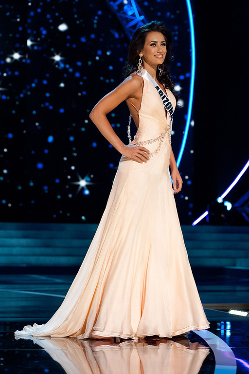 . This photo provided by the Miss Universe Organization, Miss Arizona USA 2013, Rachel Massie competes in her evening gown during the 2013 Miss USA Competition Preliminary Show  in Las Vegas  on Wednesday June 12, 2013.  She will compete for the title of Miss USA 2013 and the coveted Miss USA Diamond Nexus Crown on June 16, 2013.  (AP Photo/Miss Universe Organization, Patrick Prather)