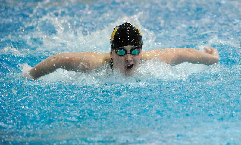 . Thompson Valley High School sophomore Eryn Eddy took a breath during the consolation heat of the Women\'s 100 Yard Butterfly event Saturday night. The Colorado Coaches Invitational Swimming and Diving Meet wrapped up Saturday night, December 15, 2012.  Karl Gehring/The Denver Post