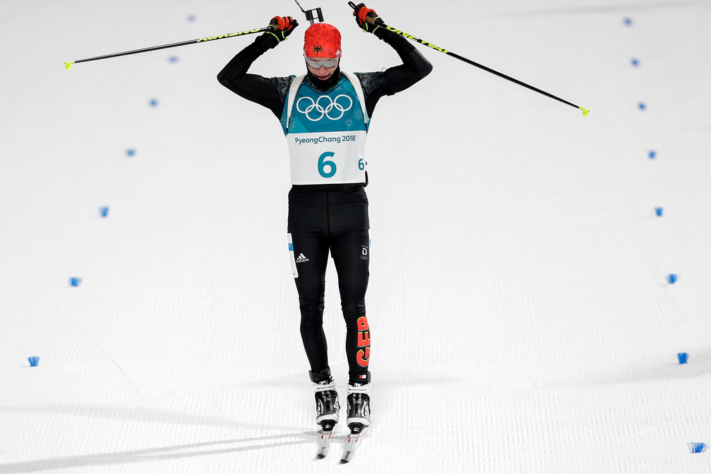 . Benedikt Doll, of Germany, celebrates his bronze medal finish during the men\'s 12.5-kilometer biathlon pursuit at the 2018 Winter Olympics in Pyeongchang, South Korea, Monday, Feb. 12, 2018. (AP Photo/Andrew Medichini)