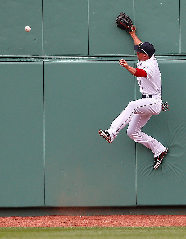 . Jacoby Ellsbury #2 of the Boston Red Sox is unable to catch a ball bit by Todd Helton #17 of the Colorado Rockies in the 4th inning at Fenway Park on June 26, 2013 in Boston, Massachusetts.  (Photo by Jim Rogash/Getty Images)