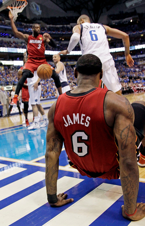 . Miami Heat\'s LeBron James (6) watches as teammate Dwyane Wade (3) dunks during the first half of Game 4 of the NBA Finals basketball game against the Dallas Mavericks Tuesday, June 7, 2011, in Dallas. (AP Photo/David J. Phillip)