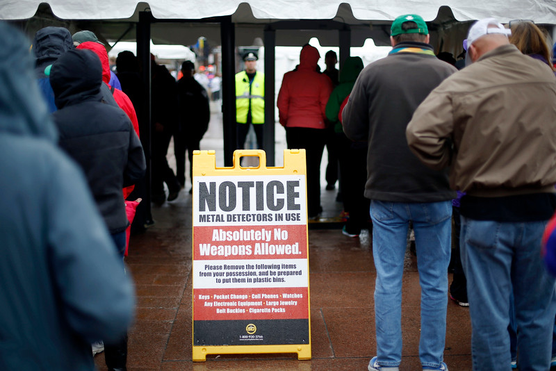 . Spectators pass through a security checkpoint near the finish line of the Boston Marathon Monday, April 20, 2015 in Boston. (AP Photo/Robert F. Bukaty)