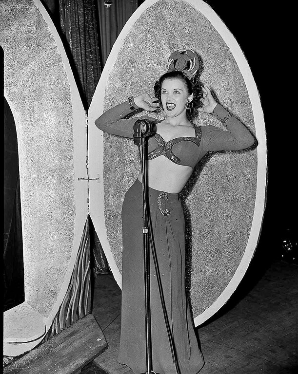 . FILE � In this Sept. 9, 1944, file photo, Venus Ramey, selected to represent the District of Columbia in the Miss America pageant as Miss Washington, D.C., performs in the talent show part of the competition before she was crowned that year\'s Miss America pageant winner in Atlantic City, N.J. Ramey, the first red-haired Miss America, died Saturday, June 17, 2017, according to the Morris & Hislope Funeral Home in Science Hill, Ky. She was 92. (AP Photo, File)
