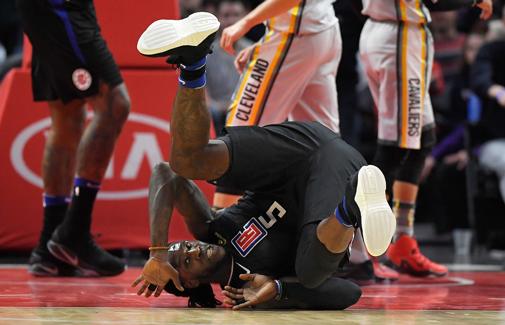 . Los Angeles Clippers forward Montrezl Harrell rolls over after scoring and drawing a foul during the first half of the team\'s NBA basketball game against the Cleveland Cavaliers, Friday, March 9, 2018, in Los Angeles. (AP Photo/Mark J. Terrill)