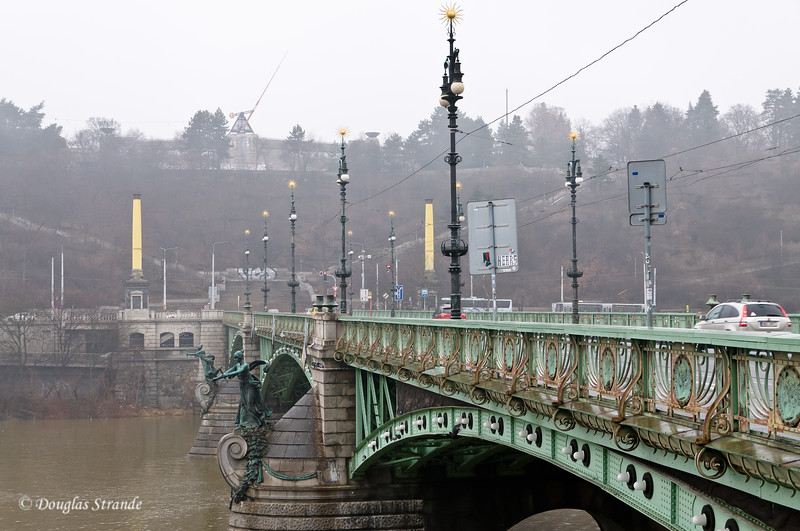 Bridge over Vlatava River, Prague.  Metronome on distant hill, replaces Stalin's statue.
