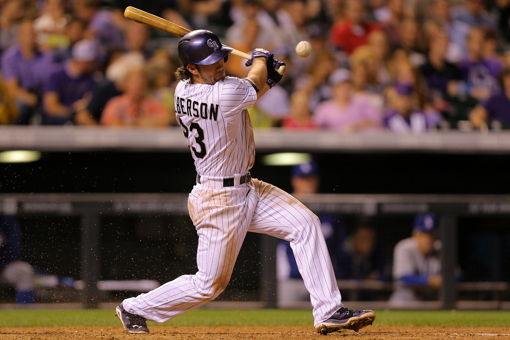 . DENVER, CO - SEPTEMBER 16:  Charlie Culberson #23 of the Colorado Rockies hits a swinging bunt single that scores two runs during the sixth inning against the Los Angeles Dodgers at Coors Field on September 16, 2014 in Denver, Colorado. (Photo by Justin Edmonds/Getty Images)