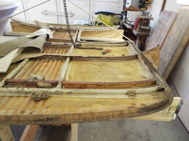 After we built a fixture to hold the top in the up side down position we are removing the old head liner.