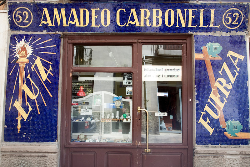 """Glazed ceramic mosaic on an electric shop facade, the signs says """"Luz"""" (light) and """"fuerza"""" (power), town of Barcelona, autonomous commnunity of Catalonia, northeastern Spain"""