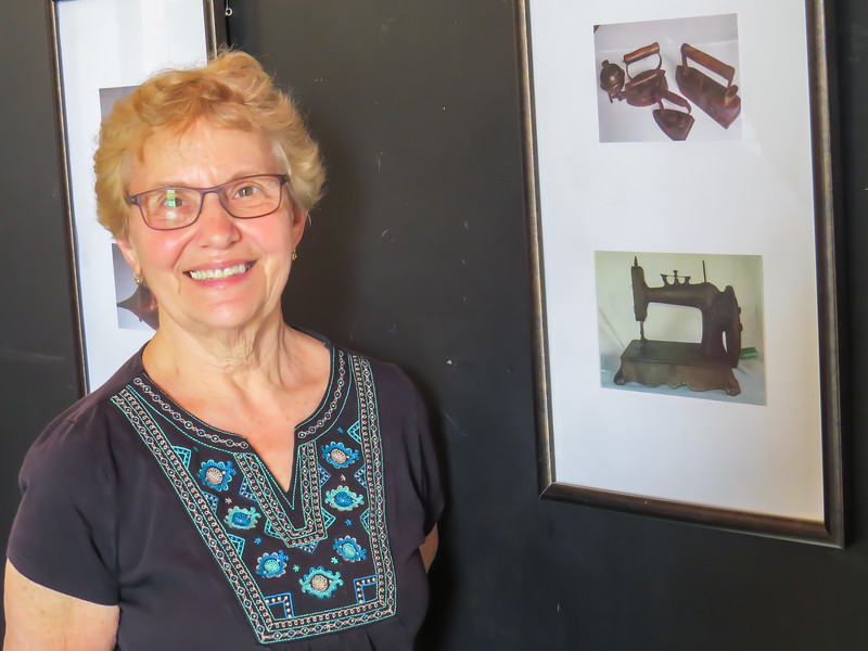 Judy (GV - Boston) used the treadle sewing machines at the Church to make aprons with material she brought from home.