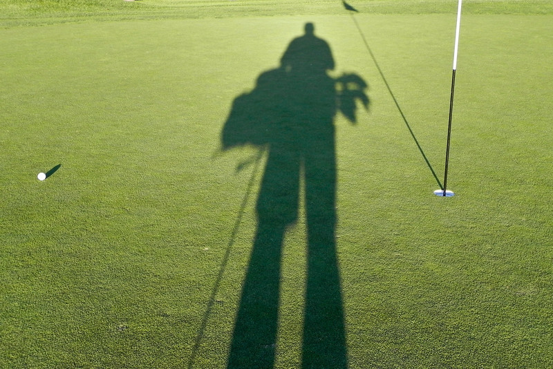 2011/6/14b – I'm walking up on my putt on the 9th green. This is a second image in a series of golf shadows. I hadn't planned to shoot this one, but I enjoy these long shadows when I'm golfing in the evenings. You can see the previous image here: http://tinyurl.com/3u5bygs