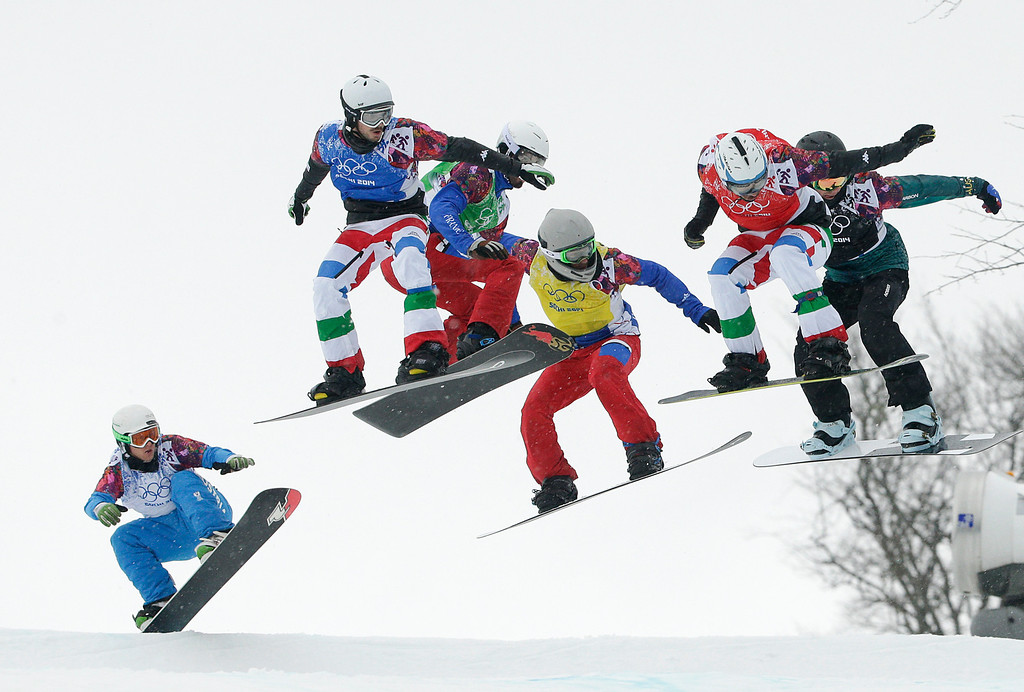 . Austria\'s Hanno Douschan, from left, Italy\'s Luca Matteotti, France\'s Pierre Vaultier, France\'s Paul-Henri de Le Rue, Italy\'s Omar Visintin, and Australia\'s Cameron Bolton compete during the men\'s snowboard cross semifinal at the Rosa Khutor Extreme Park, at the 2014 Winter Olympics, Tuesday, Feb. 18, 2014, in Krasnaya Polyana, Russia. (AP Photo/Jae C. Hong)