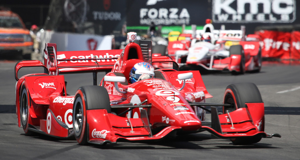 . Scott Dixon ledes Juan Pablo Montoya at the 41st Toyota Grand Prix of Long Beach, Sunday April 19th, 2015.  Chuck Bennett/Staff Photographer.