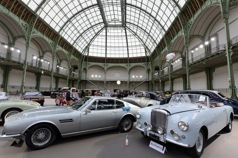 . Luxury vintages cars are displayed at an auction at the Grand Palais on February 6, 2013 in Paris. 125 vintage motor cars, 100 collection motorbikes and a 1920\'s Gipsy Moth plane by De Havilland, will be presented at the Bonhams auction on February 7.  BERTRAND GUAY/AFP/Getty Images