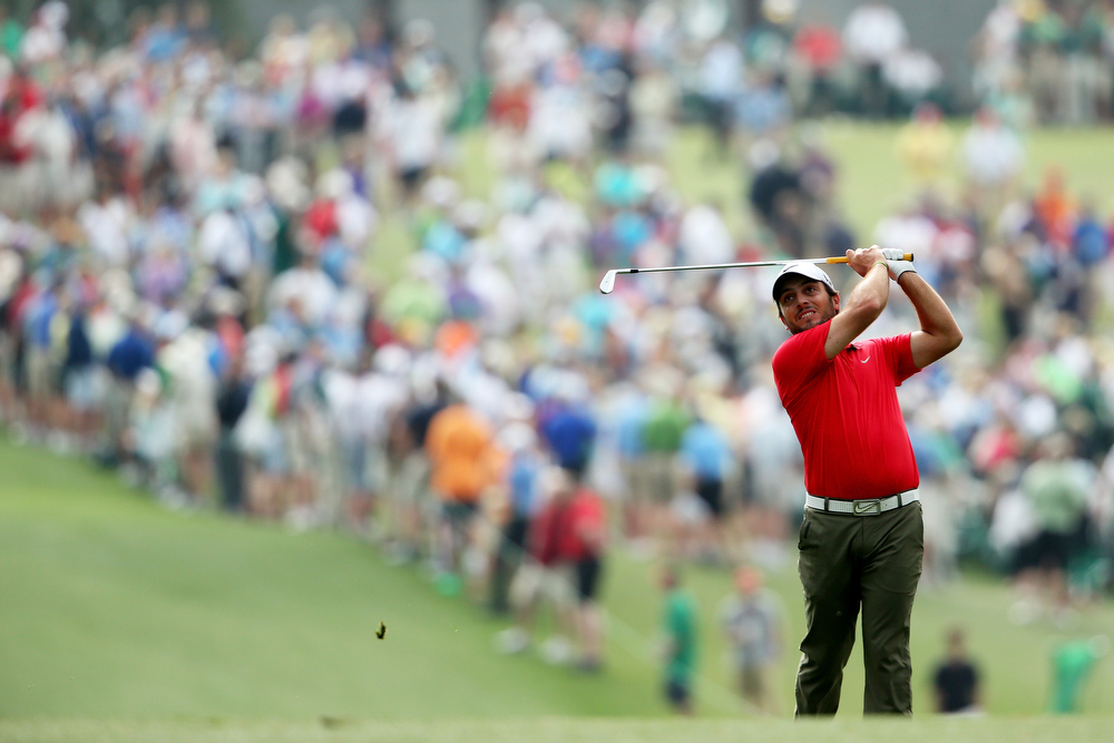 Description of . Francesco Molinari of Italy hits a shot on the first hole during the second round of the 2013 Masters Tournament at Augusta National Golf Club on April 12, 2013 in Augusta, Georgia.  (Photo by Andrew Redington/Getty Images)