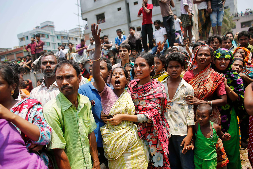 . People mourn for their relatives, who are trapped inside the rubble of the collapsed Rana Plaza building, in Savar, 30 km (19 miles) outside Dhaka April 24, 2013.  REUTERS/Andrew Biraj
