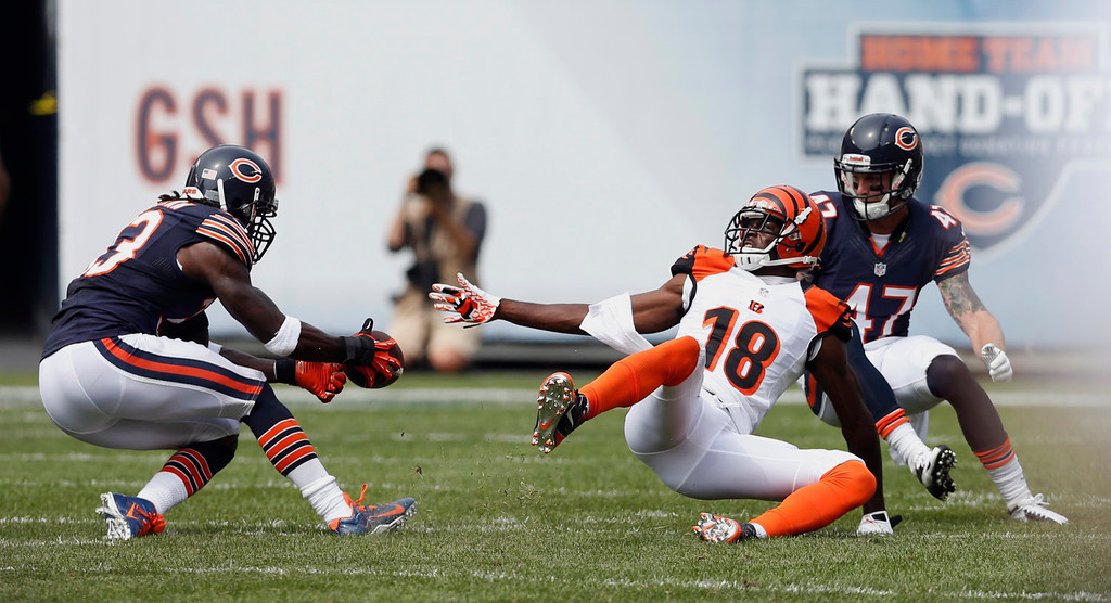 . Chicago Bears cornerback Charles Tillman, left, intercepts a pass intended for Cincinnati Bengals wide receiver A.J. Green (18) during the first half of an NFL football game, Sunday, Sept. 8, 2013, in Chicago. (AP Photo/Charles Rex Arbogast)