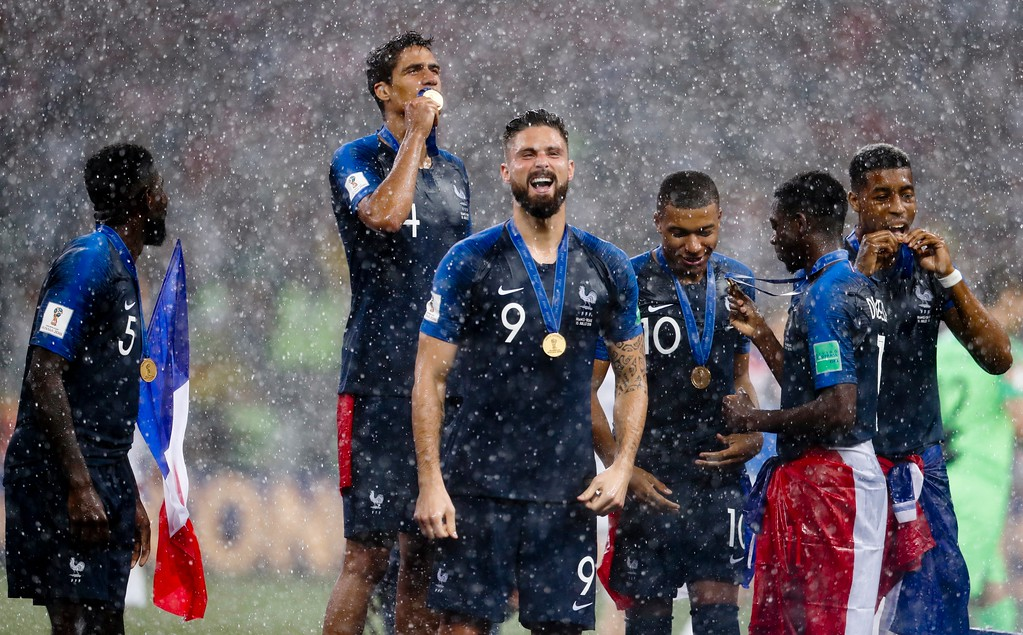 . France\'s Raphael Varane kisses his medal as he celebrates with teammates at the end of the final match between France and Croatia at the 2018 soccer World Cup in the Luzhniki Stadium in Moscow, Russia, Sunday, July 15, 2018. France won 4-2. (AP Photo/Petr David Josek)