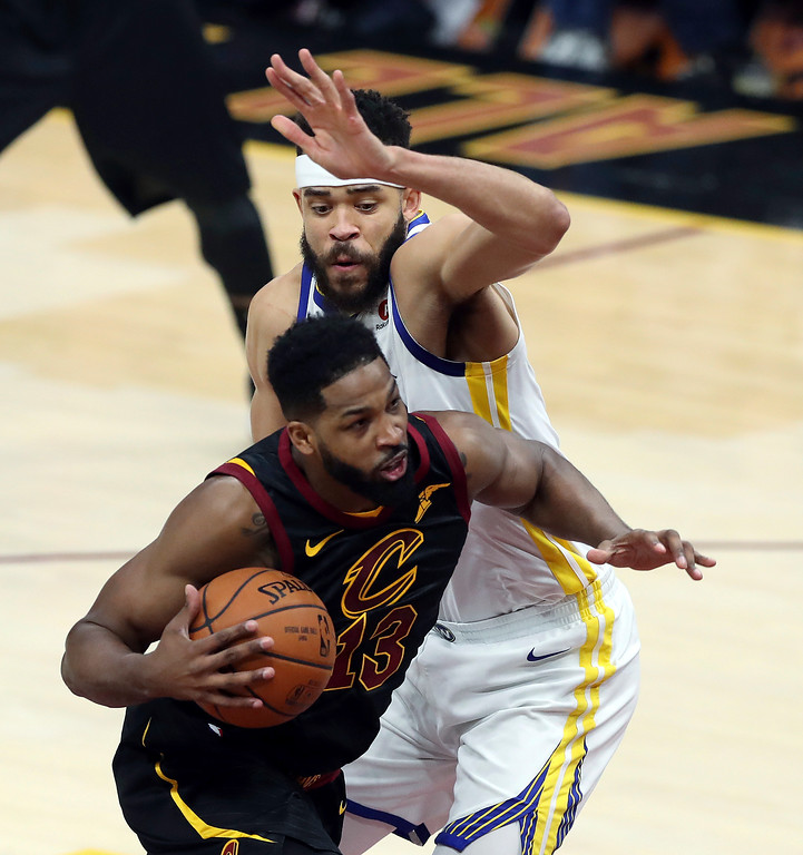 . Cleveland Cavaliers\' Tristan Thompson goes to the basket against Golden State Warriors\' JaVale McGee during the first half of Game 4 of basketball\'s NBA Finals, Friday, June 8, 2018, in Cleveland. (AP Photo/Carlos Osorio)