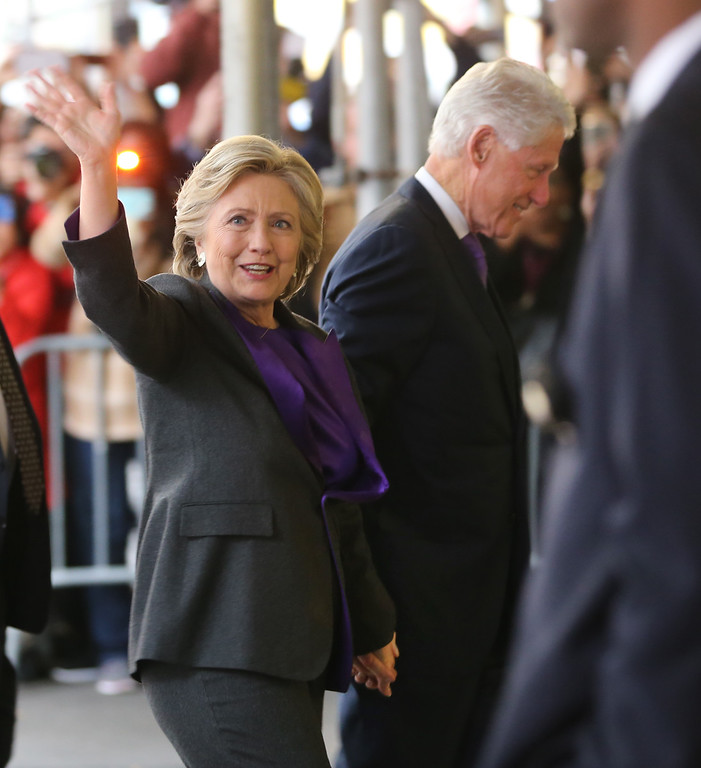 . Hillary Clinton, holding hands with her husband, former President Bill Clinton, waves to a crowd outside a New York hotel as she arrives to speak to her staff and supporters after losing the race for the White House, Wednesday, Nov. 9, 2016. Earlier in the day she conceded the race to Republican president-elect Donald Trump. (AP Photo/Seth Wenig)