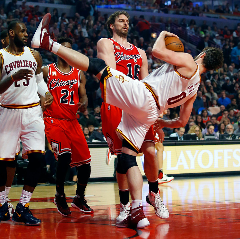 . Chicago Bulls center Pau Gasol (16) pushes Cleveland Cavaliers forward Kevin Love (0) after a rebound during the second half of an NBA basketball game in Chicago on Saturday, April 9, 2016. (AP Photo/Jeff Haynes)