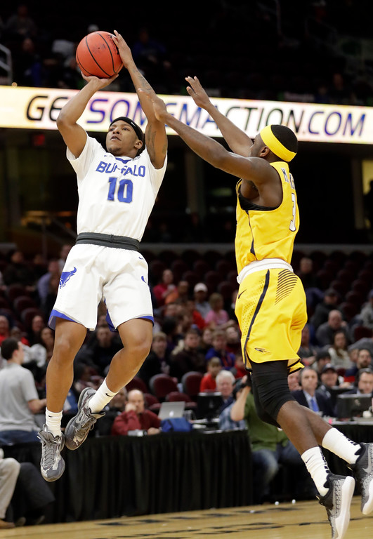 . Buffalo\'s Wes Clark (10) shoots against Toledo\'s Marreon Jackson (3) during the first half of an NCAA college basketball championship game of the Mid-American Conference tournament, Saturday, March 10, 2018, in Cleveland. (AP Photo/Tony Dejak)