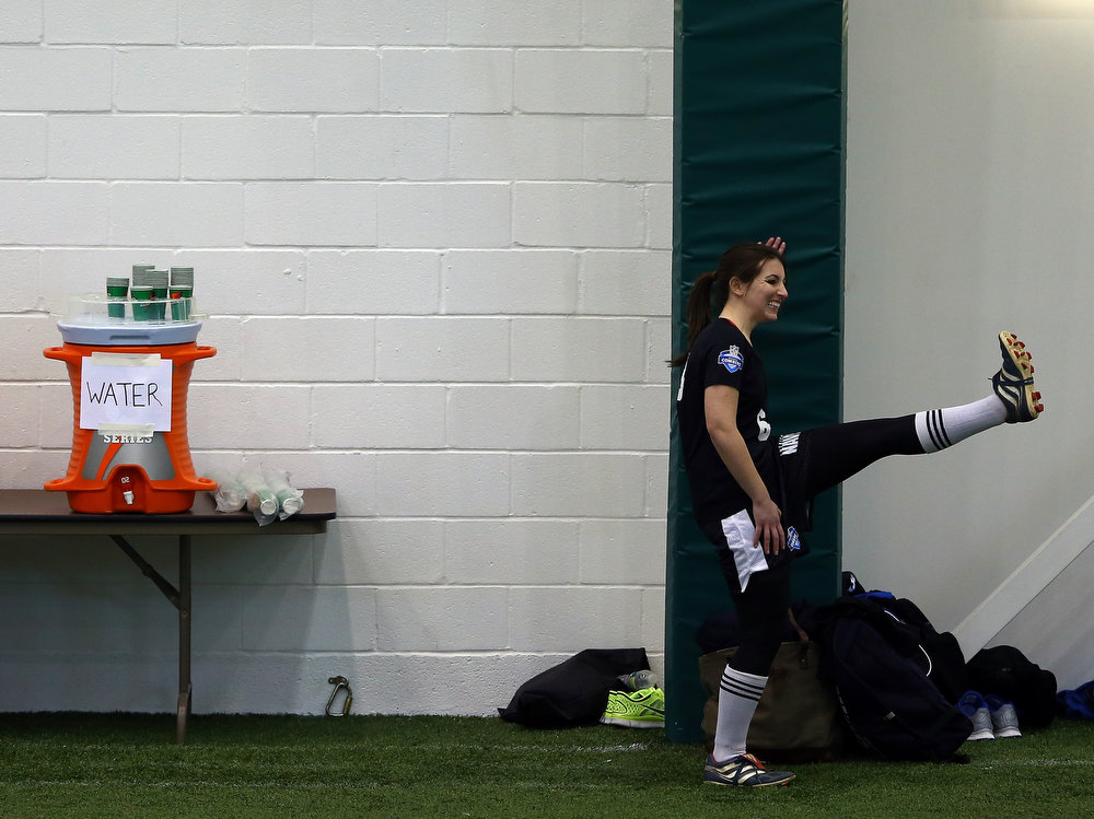 . Lauren Silberman stretches before she participates in NFL Regional Scouting Combine on March 3, 2013 at the Atlantic Health Training Center in Floram Park, New Jersey. Silberman is the first  female to try out for the NFL. (Photo by Elsa/Getty Images)