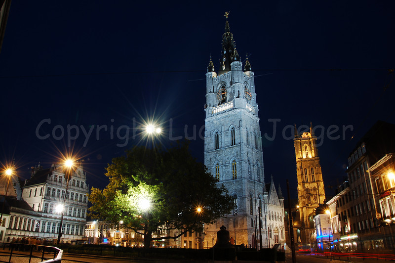 The Emile Braunplein and two of the three towers that mark Ghent (Gent) in Belgium: in front is the Belfry (Belfort) and in the background the Cathedral of St bavo (St Baafskathedraal). The white building to the left is the town hall.