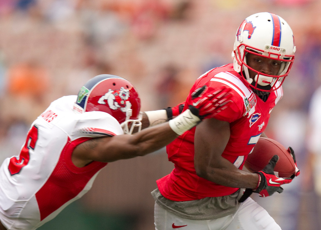 . Fresno State defensive back L.J. Jones (6) grabs SMU wide receiver Der\'rikk Thompson (7) from behind and pushes him out of bounds in the second quarter of the Hawaii Bowl in an NCAA college football game Monday, Dec. 24, 2012, in Honolulu. (AP Photo/Eugene Tanner)
