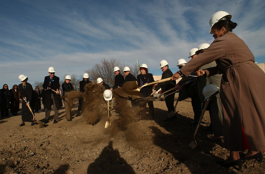 . Aurora officials, including Mayor Paul Tauer,  participate in the groundbreaking ceremony of the new Martin Luther King, Jr. / Municipal Services Center to be built on East Colfax between Emporia and Elmira Streets.  The building will be completed in December  and will be 30,000 square feet. It will house the library, some city service offices and a police department. Aurora City Councilwoman Edna Mosley is on the far right. (Photo by Lyn Alweis/The Denver Post)