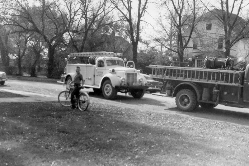 AR068.  Unknown‡ on bicycle – Arthur fire trucks – 1963.jpg