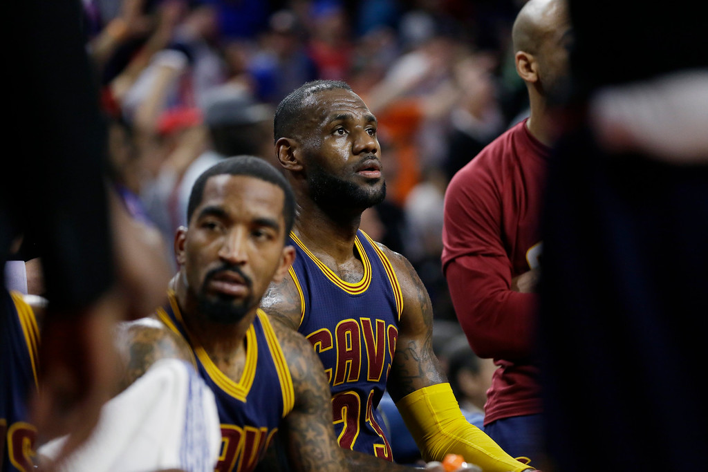 . Cleveland Cavaliers forward LeBron James, center, sits on the bench during the second half in Game 4 of a first-round NBA basketball playoff series against the Detroit Pistons, Sunday, April 24, 2016 in Auburn Hills, Mich.(AP Photo/Carlos Osorio)