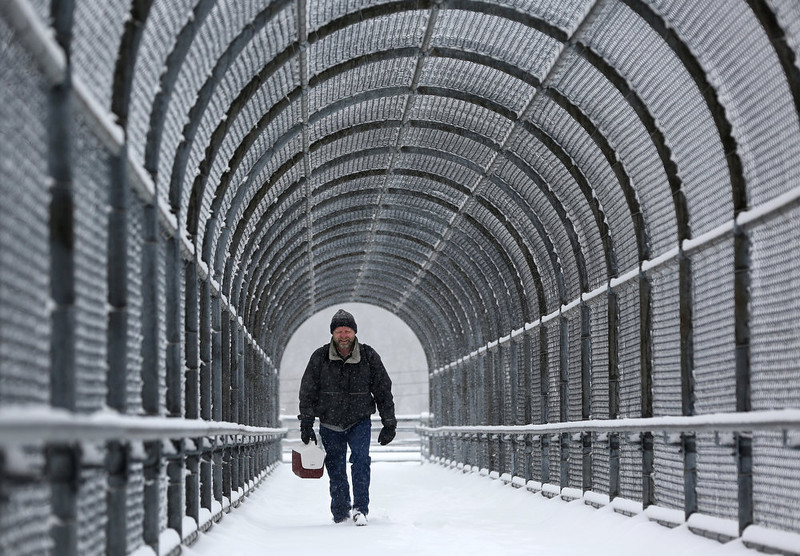 """. Kevin Anderson trudges through the snow on his way home from work Tuesday, March 5, 2013, in Dubuque, Iowa.  This will be the biggest widespread storm of the winter,\"""" National Weather Service meteorologist Amy Seeley said.  (AP/Telegraph Herald/Jessica Reilly)"""