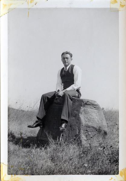 Norman sitting on Rock 1938.jpg