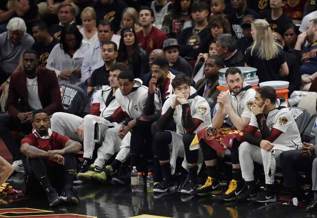 . Cleveland Cavaliers players watch from the bench during the second half of Game 4 of basketball\'s NBA Finals against the Golden State Warriors, Friday, June 8, 2018, in Cleveland. (AP Photo/Tony Dejak)