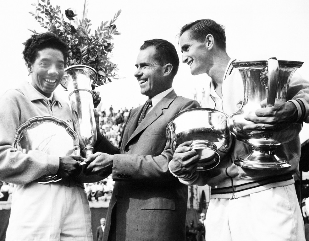 . Vice President Richard Nixon presents winners\' trophy to New York\'s Althea Gibson, the first black woman ever  to win the National Tennis Championships women\'s title in Forest Hills, N.Y., Sept. 8, 1957.  At right is Mal Anderson of Australia, winner in the men\'s division.  (AP Photo/Harris Harris)