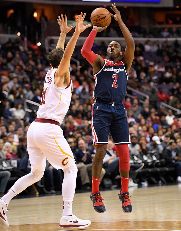 . Washington Wizards guard John Wall (2) shoots over Cleveland Cavaliers guard Jose Calderon, left, during the second half of an NBA basketball game, Sunday, Dec. 17, 2017, in Washington. The Cavaliers won 106-99. (AP Photo/Nick Wass)