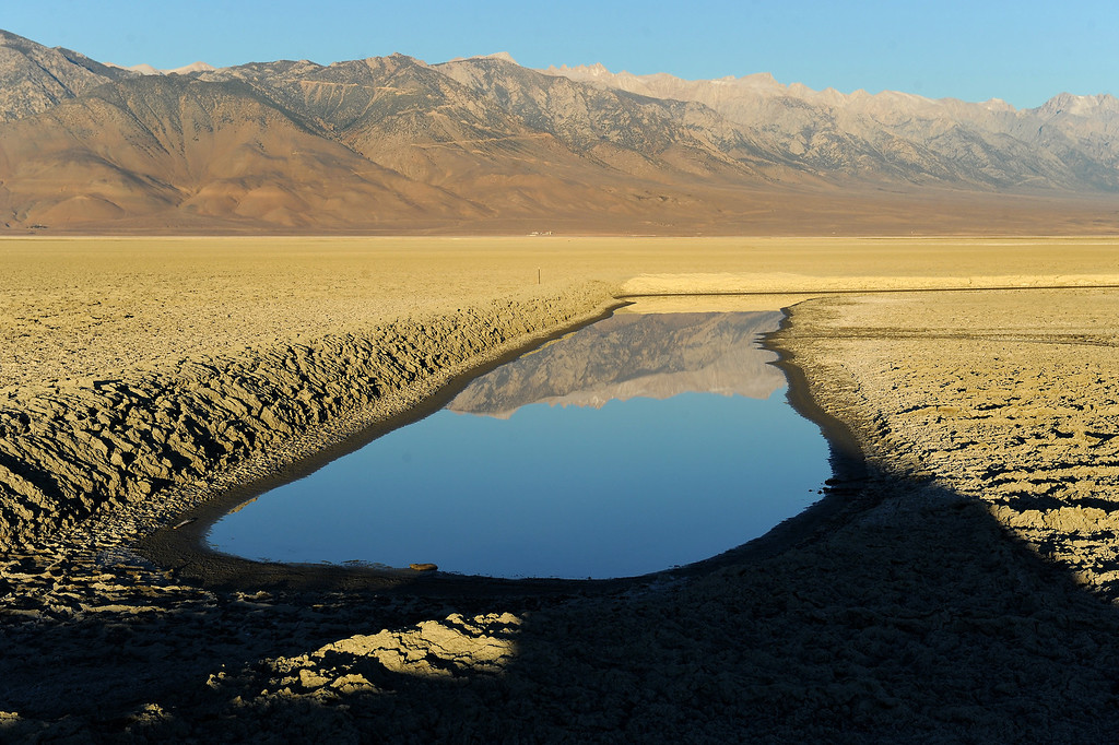 . The Sierra Nevada Mountains are reflected in Owens Lake. The DWP is refilling Owens Lake as part of a mitigation effort to reduce dust storms created as a result of diverting the Owens River for the L.A. Aqueduct. (Photo by Michael Owen Baker/L.A. Daily News)